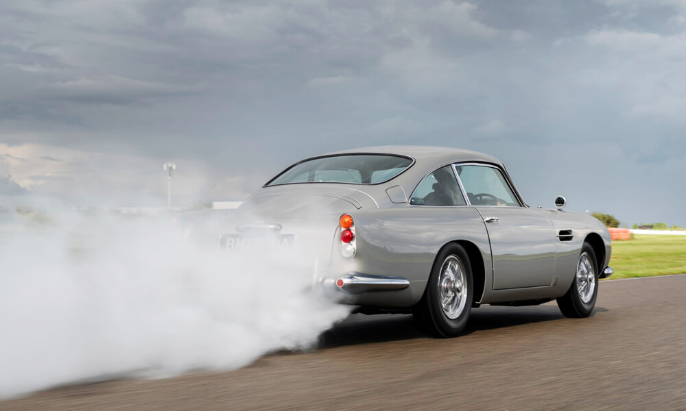The Aston Martin DB5 Goldfinger Continuation's rear smoke screen delivery system in action. Credit: Aston Martin