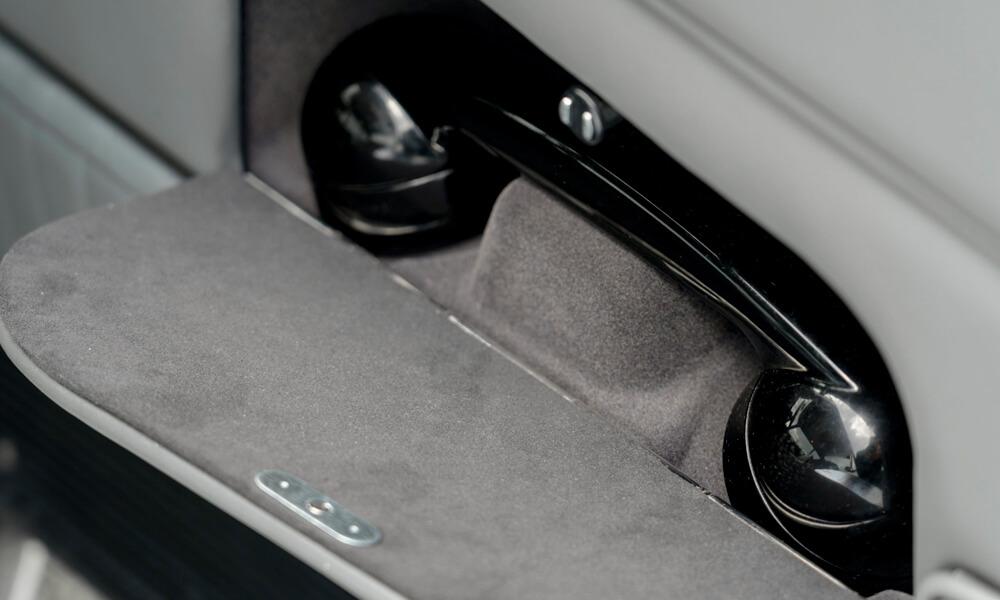 Telephone in drivers door. Credit: Aston Martin