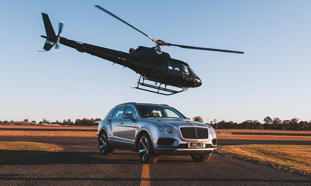 Bentley Bentayga with Airbus H125 Helicopter Flyinjg