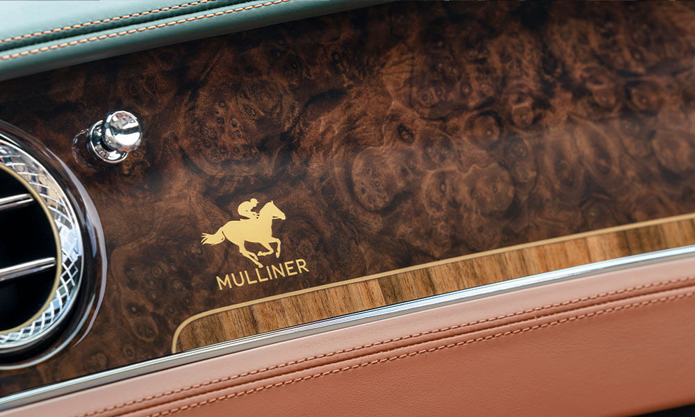 Bentley Mulliner Continental GT Convertible Equestrian Edition Burr Walnut dashboard and gold logo