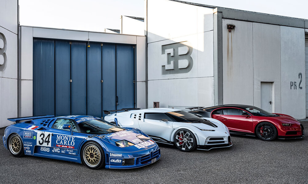 Bugatti Centodieci flanked by the blue EB110 Super Sport and red Chiron
