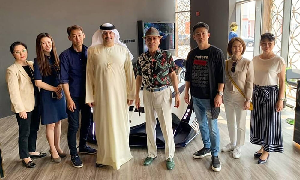 Devel Motors Majid AlAttar with Tetsumi Shinchi and Family in front of the Devel Sixteen