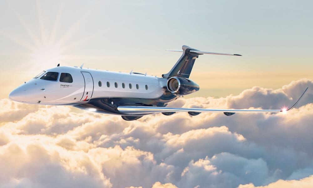 Embraer Praetor 600 flying over clouds