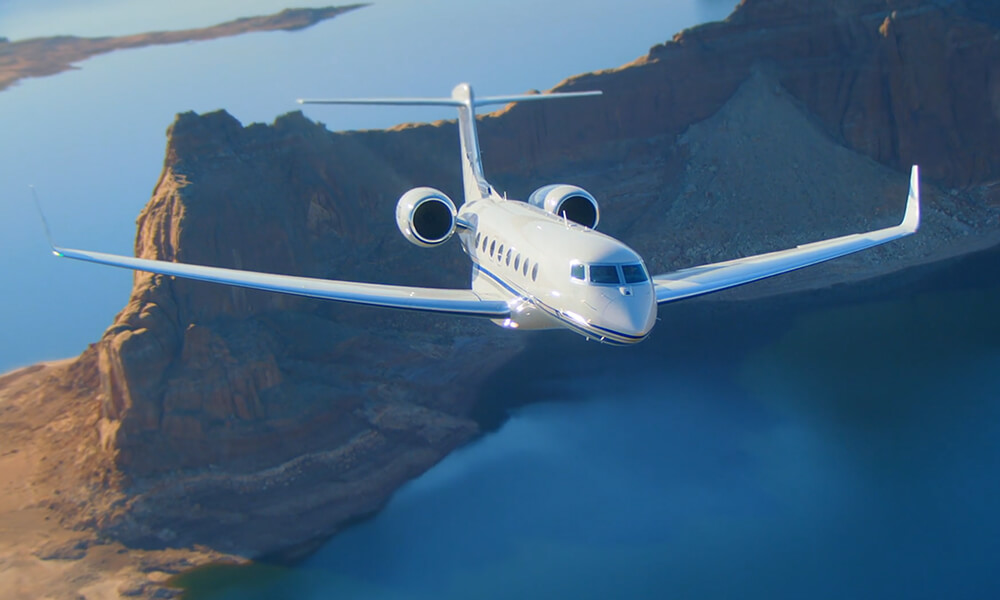 G650ER Flying over Lake