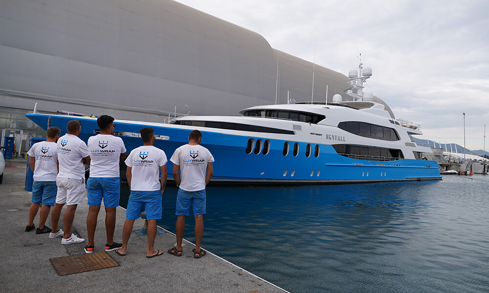 LuxWrap team admire their completed wrap of Superyacht SKYFALL
