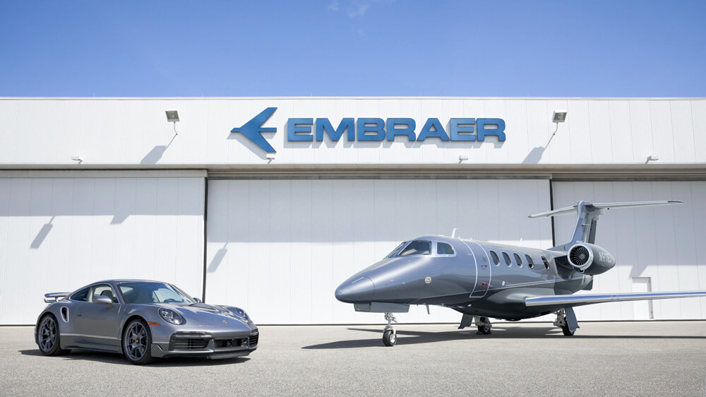"Matching ""Duet"" Porsche 911 Turbo S and Embraer Phenom 300E. Credit: Porsche & Embraer"