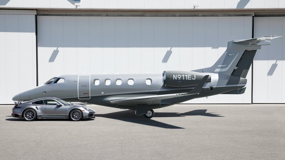 Matching metallic Platinum and Jet Gray Metallic paint with aviation inspired twin stripes. Credit: Porsche & Embraer