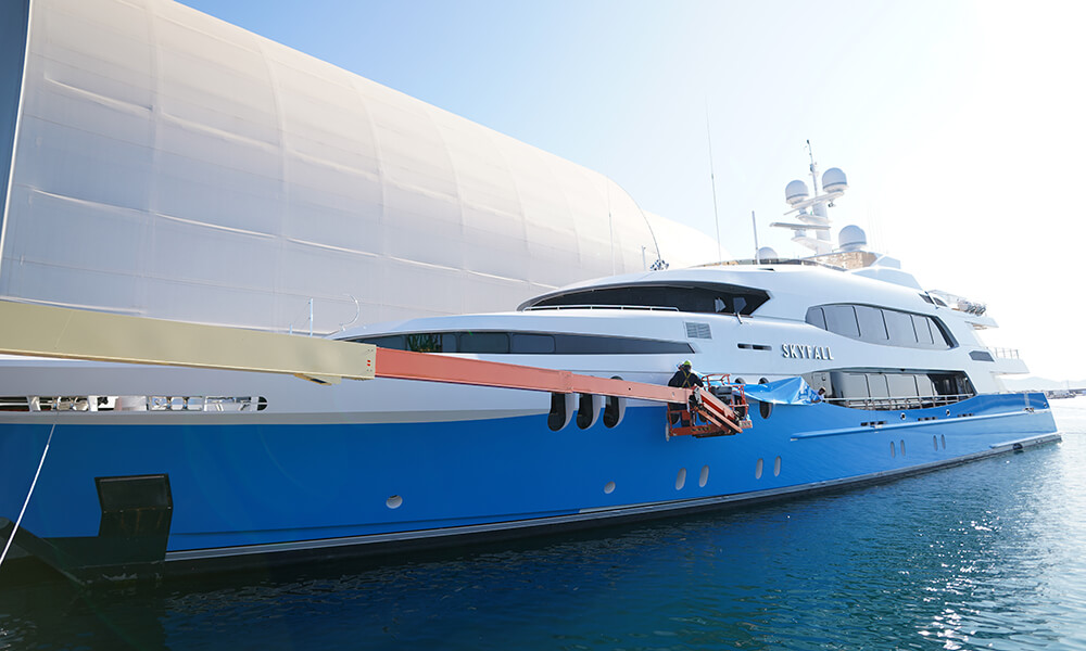 Using an elevated work platform to access Superyacht SKYFALL during wrap project
