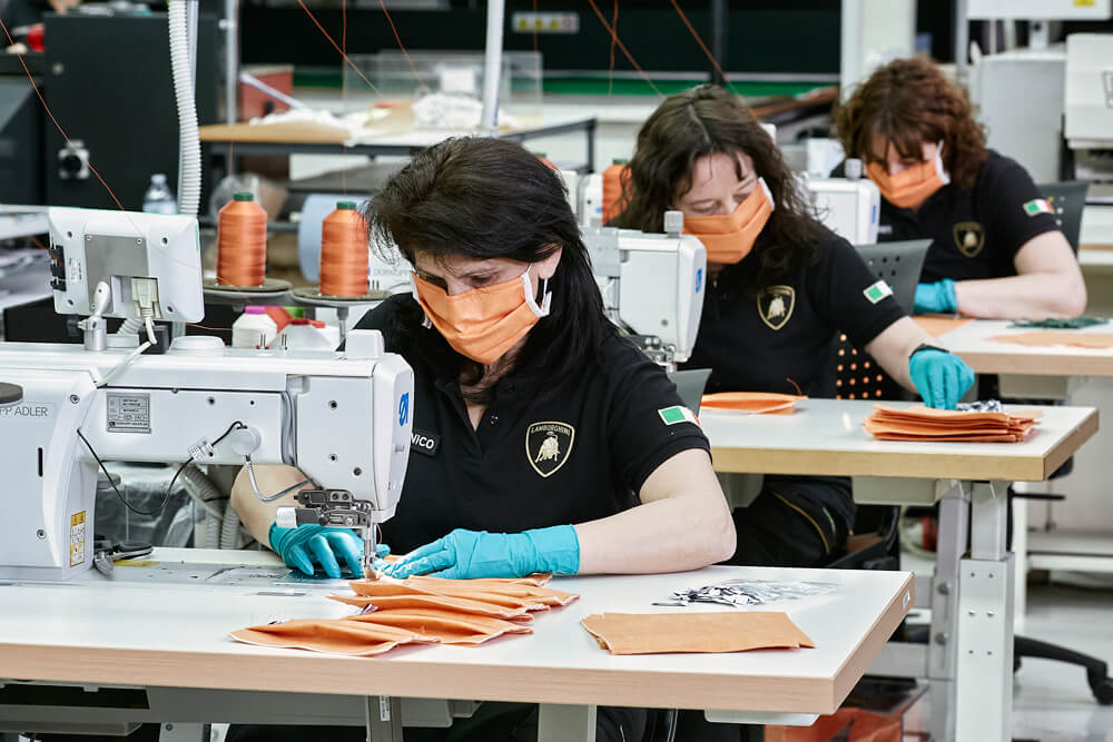 Lamborghini factory staff make surgical masks to help hospitals with coronavirus pandemic. Credit: Lamborghini