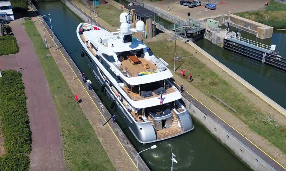Superyacht W built by Feadship navigates a Dutch canal